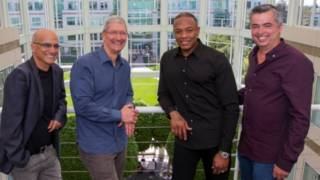 Jimmy Iovine, Apple CEO Tim Cook, Beats co-founder Dr. Dre, and Apple senior vice president Eddy Cue