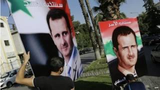 Плакаты с портретом Ассада