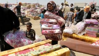 Mujer en campo de refugiados