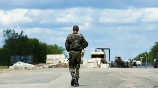 Вооруженный человек на Украине