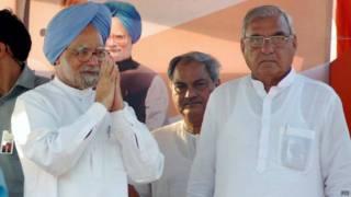 हूड्डा पूर्व प्रधानमंत्री मनमोहन सिंह के साथ
