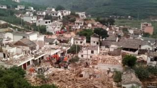 Разрушенные дома в уезде Лудян
