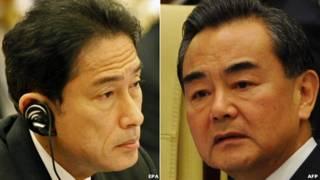 وزير خارجية الصين (يمين) ووزير خارجية اليابان (يسار)