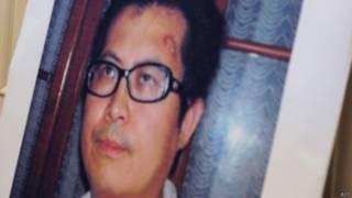 郭飞雄照片被放在美国国会众议院外交委员会一场会议上(29/10/2013)
