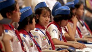 Girls scout member attend the ceremony of the International Day of Democracy at the parliament building in Naypyitaw