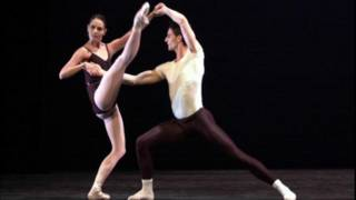 Two ballet dancers performing on stage