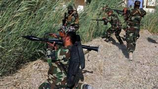Milicianos xiitas enfrentam o 'EI' no Iraque (EPA)
