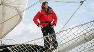 A man standing on a tall ship