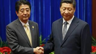 Председатель КНР Си Цзиньпин и премьер министр Японии Синдзо Абэ
