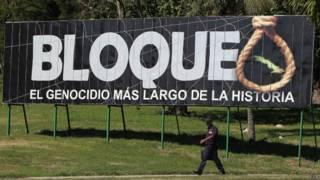 Cartel sobre embargo en Cuba.