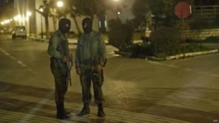 Вооружённые мужчины в масках