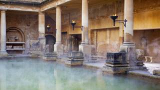 Steam rising at the Roman Baths in the city of Bath, England