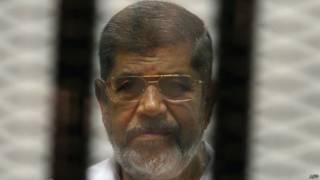 Мохаммед Мурси в зале суда в мае 2014 года