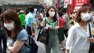 Mulheres em Seul (AP)