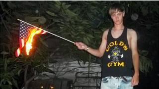 dylann_roof_burning_us_flag