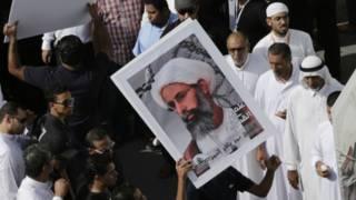 Демонстрация с портретом аль-Нимра