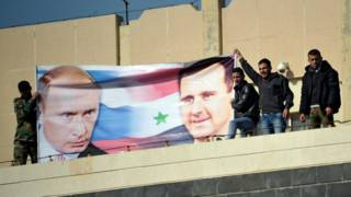 Плакат с Путиным и Асадом в Сирии