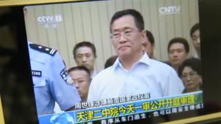 Ảnh từ video của AP, ông Chu Thế Phong tại phiên xử ở Thiên Tân hôm 4/8/2016.