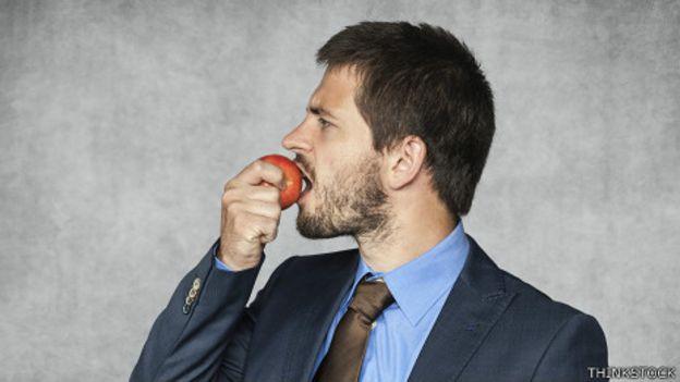 Executive eating an apple