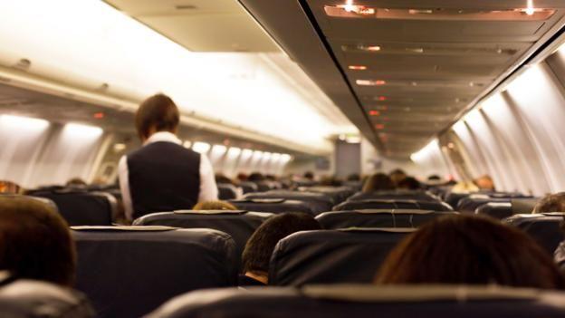 151109162513 flight attendant in plane