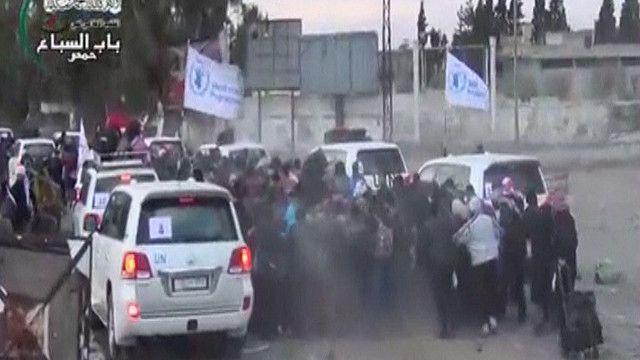 سوريون يتم إجلاؤهم من وسط حمص