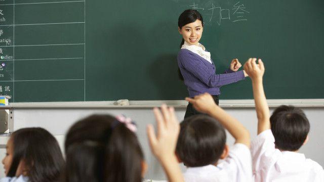 A teacher and children in a classroom