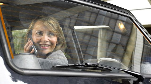 a woman sitting in the back seat of a car
