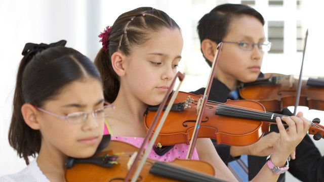 Children practising the violin