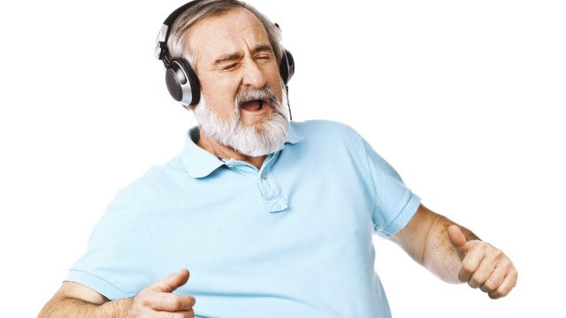 A man singing with headphones on