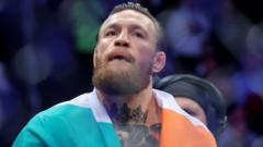 Conor McGregor is draped in the Irish flag after his win over Donald Cerrone in January