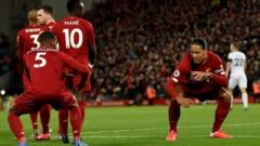 Georginio Wijnaldum and Virgil van Dijk celebrate scoring for Liverpool