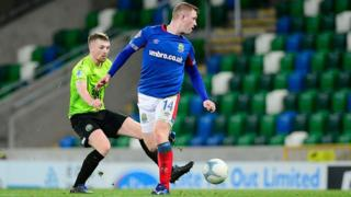 Shayne Lavery scores his second of the night for Linfield