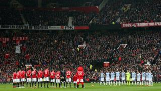 Players and fans observed a minute's silence before kick-off