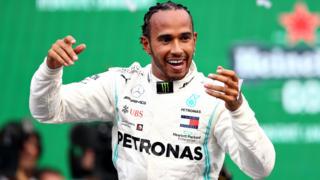 Lewis Hamilton celebrates after winning the Mexico Grand Prix