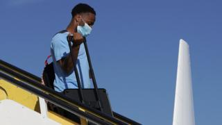Sterling gets off a plane