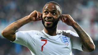 England winger Raheem Sterling puts his hands to his ears after scoring against Montenegro in response to racist chants from the stands