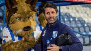 Danny Cowley with the Huddersfield mascot