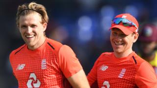 England players David Willey and Eoin Morgan celebrate