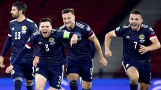 Scotland players celebrate their penalty shootout win over Israel
