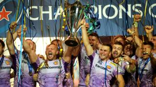 Exeter celebrate with the Champions Cup trophy