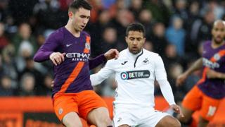 "Manchester City""s Aymeric Laporte in action with Swansea City""s Wayne Routledge"