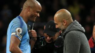 Vincent Kompany and pep Guardiola after the Manchester City win over Leicester