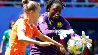 Netherlands' Vivianne Miedema in action with Cameroon's Annette Ngo