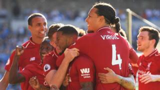 Wijnaldum celebrates with team