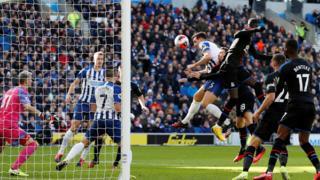 Brighton head at goal
