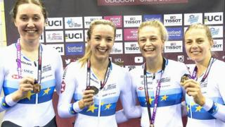 Katie Archibald, Elinor Barker, Eleanor Dickinson and Noah Evans posing with the gold medals on day one of the Track Cycling World Cup in Glasgow.