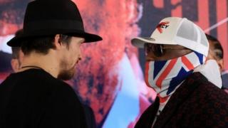 Usyk and Chisora stare down