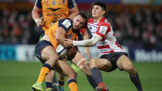 Gloucester Rugby's Louis Rees Zammit in action with Montpellier's Henry Immelman