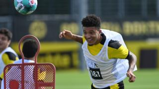 Jadon Sancho heads the ball in training
