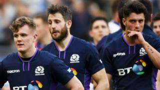 Darcy Graham, Tommy Seymour and Adam Hastings look dejected after Scotland's defeat